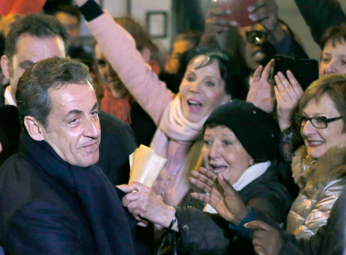 Former French president Nicolas Sarkozy (L) is greeted by well-wishers as he leaves his campaign headquarters after he won his UMP (Union for a Movement Popular) politial party member's online vote for its new leader in Paris November 29, 2014. (Reuters/Gonzalo Fuentes)