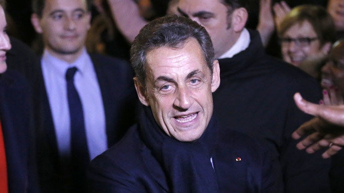 Former French president Nicolas Sarkozy is greeted by well-wishers as he leaves his campaign headquarters after he won his UMP (Union for a Movement Popular) politial party member's online vote for its new leader in Paris November 29, 2014. (Reuters/Gonzalo Fuentes)