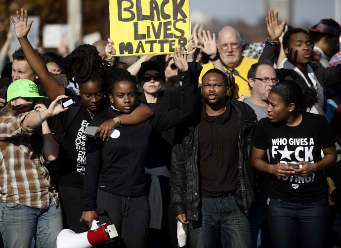 Demonstrators protest the shooting death of Michael Brown November 29, 2014 in Brentwood, Missouri. (oshua Lott/Getty Images/AFP)