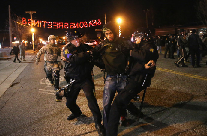 Police arrest a demonstrator outside the police station November 28, 2014 in Ferguson, Missouri. (Scott Olson/Getty Images/AFP)