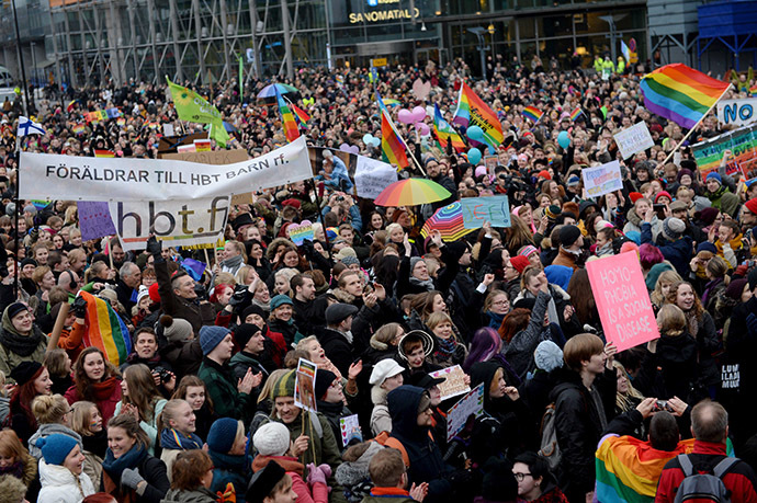 Supporters of the same-sex marriage celebrate outside the Finnish Parliament in Helsinki, Finland on November 28, 2014 after the Finnish parliament approved a bill allowing homosexual marriage. (AFP Photo/Lehtikuva)