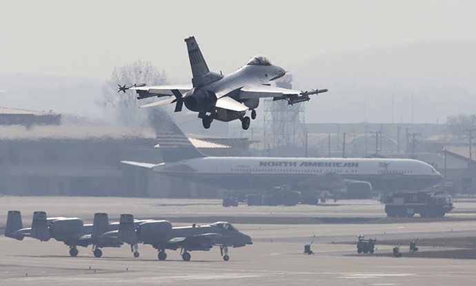A F-16 fighter jet (top) belonging to the U.S. Air Force comes in for a landing at a U.S. air force base in Osan, south of Seoul April 3, 2013. (Reuters/Lee Jae-Won)
