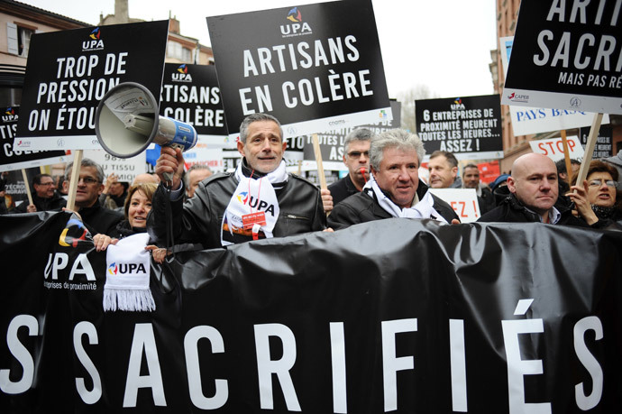 French bosses hold signs as they protest on December 1, 2014 in Toulouse against 30 years of government economic policies that have, according to them, stunted economic growth. (AFP Photo / Remy Gabalda)