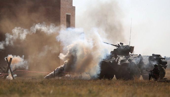 Russian military vehicles during the joint anti-terrorist Russian-Indian drills, Indra-2014, at the Prudboy range in the Volgograd Region. (RIA Novosti / Kirill Braga)