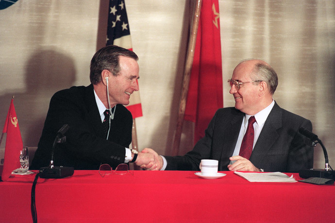 Photo taken 03 December 1989 aboard of the Soviet cruise liner Maxim Gorky of US President George Bush (L) shaking hands with Soviet leader Mikhail Gorbatchev during a joint press-conference after the first US-Soviet summit meeting. This summit is viewed as the official end of the Cold War. (AFP Photo)
