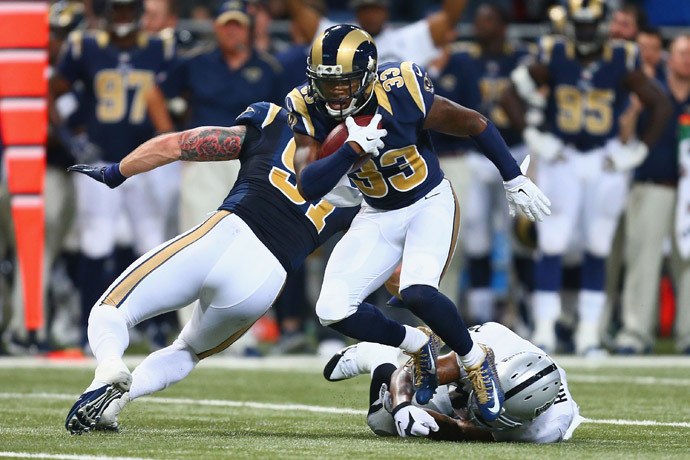 E.J. Gaines #33 of the St. Louis Rams returns an interception against the Oakland Raiders in the second quarter at the Edward Jones Dome on November 30, 2014 in St. Louis, Missouri. (Dilip Vishwanat / Getty Images / AFP)