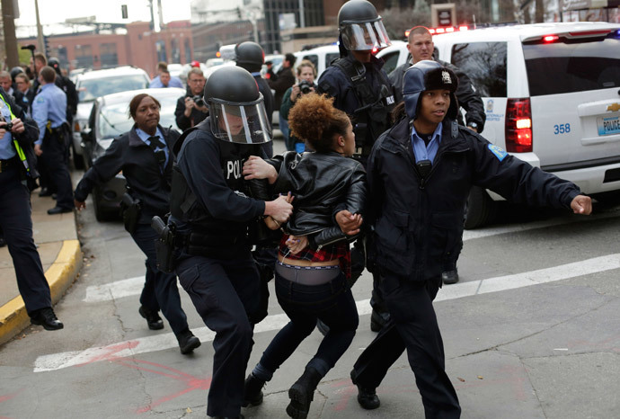 A demonstrator protesting the shooting death of Michael Brown is arrested by police officers in riot gear November 30, 2014 in St. Louis, Missouri. (Joshua Lott / Getty Images / AFP)