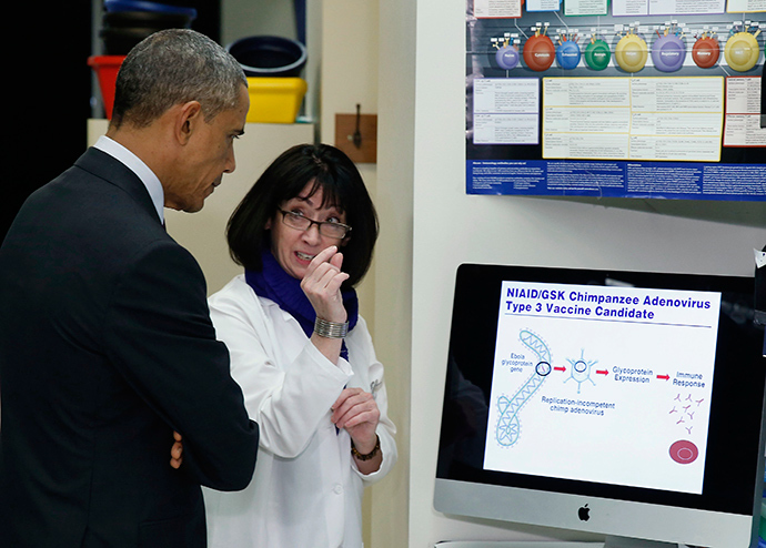 U.S. President Barack Obama listens as Dr. Nancy Sullivan talks about Ebola in the Vaccine Research Center during his visit to the National Institutes of Health in Bethesda, Maryland December 2, 2014 (Reuters / Larry Downing)
