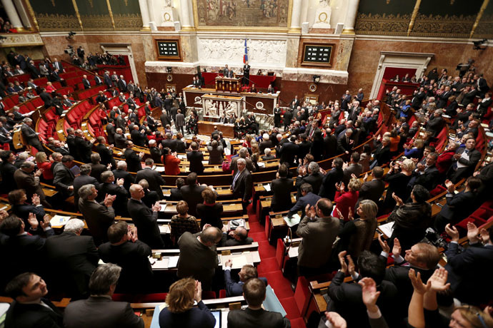 General view of the hemicycle as deputies applaud after the results of the vote on Palestine status at the National Assembly in Paris December 2, 2014. (Reuters/Charles Platiau)