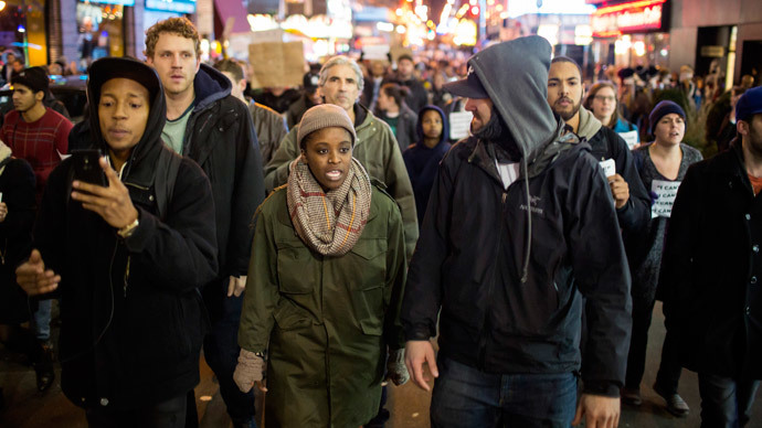 People take part in a protest against the grand jury decision on the death of Eric Garner in midtown Manhattan in New York December 3, 2014.(Reuters / Eric Thayer)