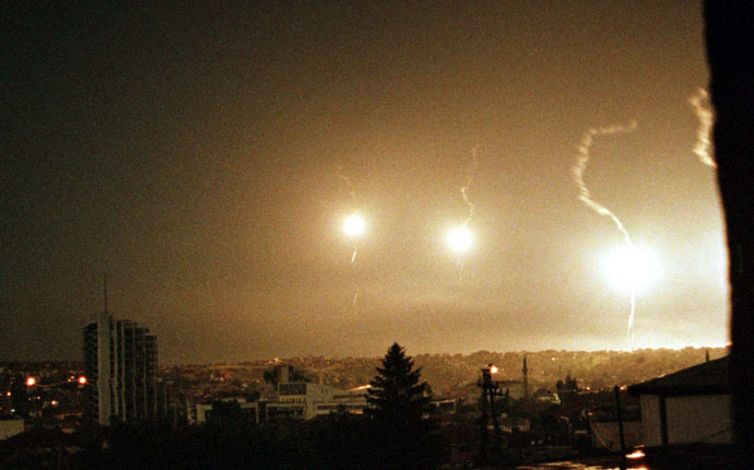 Flares illuminate the sky over Pristina during a NATO air strike early June 2, 1999 (Reuters/Goran Tomasevic)