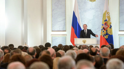 Russian President Vladimir Putin delivers the annual Presidential Address to the Federal Assembly at the Kremlin's St. George's Hall. (RIA Novosti/Grigoriy Sisoev)