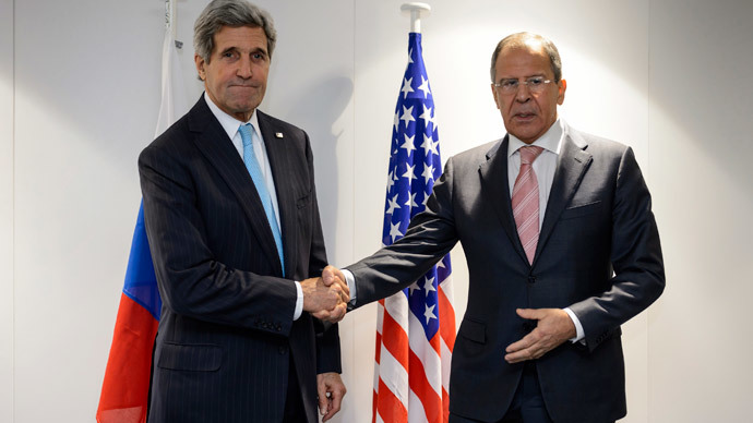 U.S. Secretary of State John Kerry (L) shake hands with Russia's Foreign Minister Sergey Lavrov at the meeting of foreign ministers from the Organization for Security and Cooperation in Europe (OSCE) in Basel December 4, 2014.(Reuters / Fabrice Coffrini)