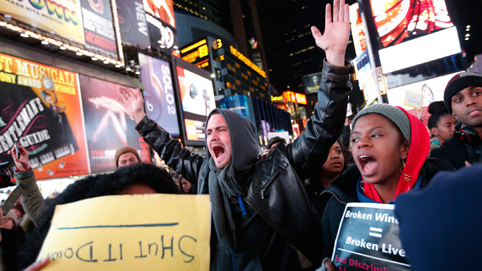 Demonstrators in Times Square protest a grand jury decision not to charge a New York policeman in the chocking death of Eric Garner, in New York December 4, 2014. (Reuters / Mike Segar)