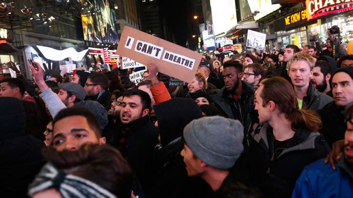 Demonstrators fill 7th Avenue in Times Square as they protest a grand jury decision not to charge a New York policeman in the choking death of Eric Garner, in New York December 4, 2014. (Reuters / Mike Segar)