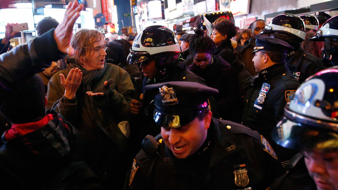 Demonstrators clash with police as they fill the streets in Times Square as they protest a grand jury decision not to charge a New York policeman in the choking death of Eric Garner, in New York December 4, 2014.(Reuters / Shannon Stapleton)