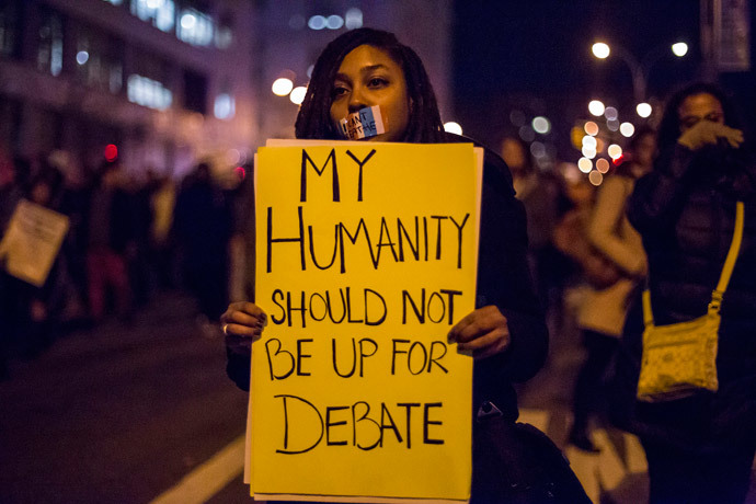 A female protester, demanding justice for Eric Garner, holds a placard in Brooklyn, New York December 4, 2014. (Reuters / Elizabeth Shafiroff)