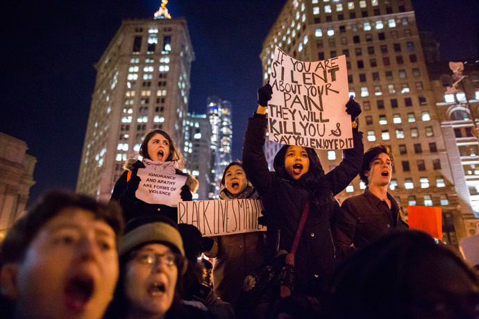 Protesters, demanding justice for Eric Garner, hold placards while shouting slogans in Foley Square, New York December 4, 2014. (Reuters / Elizabeth Shafiroff)