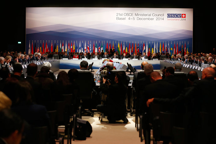 Delegates attend a meeting of foreign ministers from the Organization for Security and Co-operation in Europe (OSCE) in Basel December 4, 2014. (Reuters / Ruben Sprich)