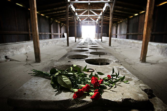 Flowers are placed inside one of the barracks of the Auschwitz-Birkenau death camp in Oswiecim. (Reuters/Damir Sagolj)