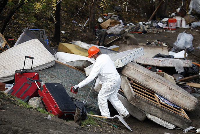 "Authorities break down a homeless encampment known as ""The Jungle"" in San Jose, California December 4, 2014. (Reuters/Beck Diefenbach)"