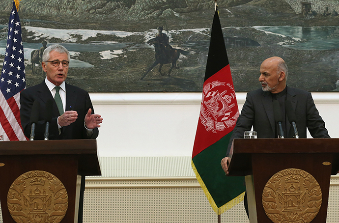 US Secretary of Defense Chuck Hagel (L) speaks during a joint news conference with Afghan President Ashraf Ghani at the Presidential Palace in Kabul on December 6, 2014. (AFP Photo / Mark Wilson / Pool)