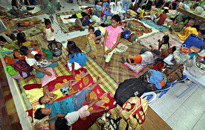 Residents rest inside an evacuation center in Surigao City, in southern island of Mindanao on December 5, 2014, ahead of the landfall of Typhoon Hagupit. (AFP Photo)