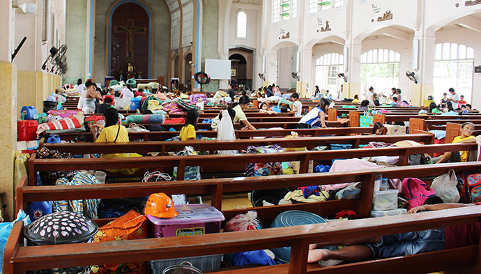 People take shelter inside a church after evacuating their homes due to super-typhoon Hagupit in Tacloban city, central Philippines December 5, 2014. (Reuters/Rowel Montes)