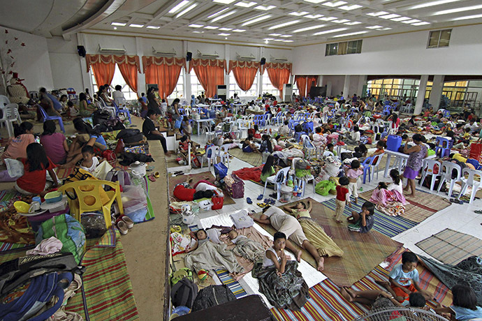 People take shelter inside a evacuation centre after evacuating from their homes due to super-typhoon Hagupit in Surigao city, southern Philippines December 5, 2014. (Reuters/Stringer)