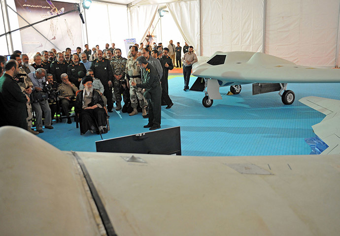 A handout picture released by the office of Iran's Supreme Leader Ayatollah Ali Khamenei on May 11, 2014 shows him (C-L) sitting next to the captured US RQ-170 sentinel high-altitude reconnaissance that crashed in Iran. (AFP Photo/Iranian Leader's Website)