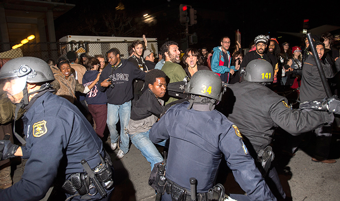 Police officers scuffle with protesters during a protest against police violence in the U.S., in Berkeley, California December 6, 2014 (Reuters / Noah Berger)