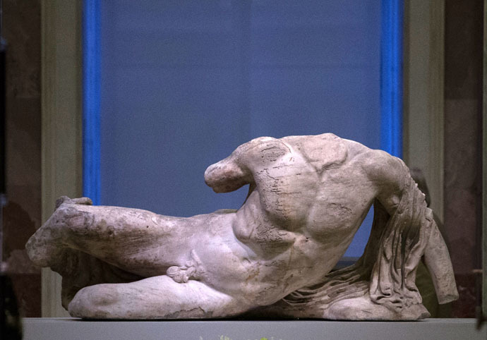 The marble sculpture of the river god Ilissos, part of the famous Elgin Marbles, which decorated the facade of Greece's Parthenon temple, at an exhibition in Hermitage State Museum. (RIA Novosti/Igor Russak)