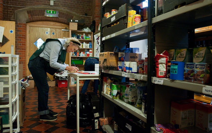 A volunteer sorts through donations of food at the Hammersmith and Fulham food bank run by the Trussell Trust in London (AFP Photo/Will Oliver)