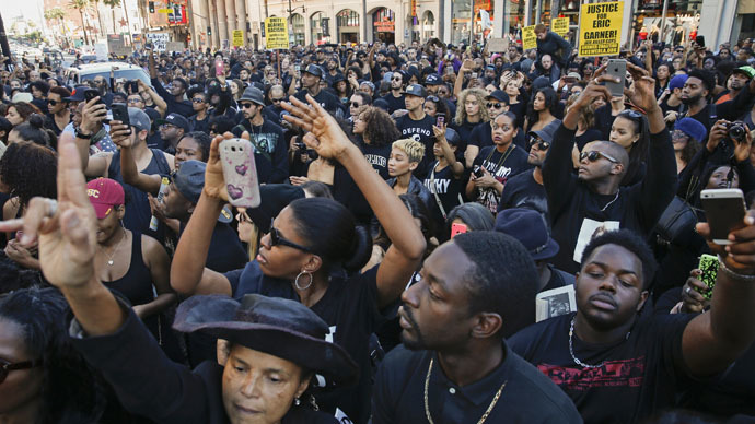 Demonstrators block traffic in front of the TCL Chinese Theatre, as they protest against police violence, including the July chokehold death of unarmed black man Eric Garner in New York, near the area where LAPD shot an assault suspect on December 5, in Hollywood, California December 6, 2014. (Reuters/Patrick T. Fallon)
