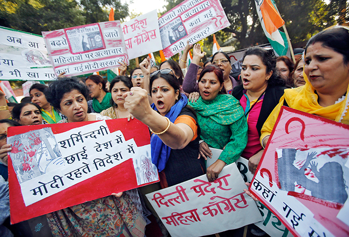 Members of All India Mahila Congress, women's wing of Congress party, shout slogans and carry placards during a protest against the rape of a female passenger, in New Delhi December 8, 2014 (Reuters / Anindito Mukherjee)