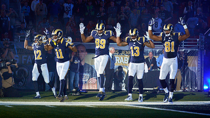 St. Louis Rams wide receiver Stedman Bailey (12) and wide receiver Tavon Austin (11) and tight end Jared Cook (89) and wide receiver Chris Givens (13) and wide receiver Kenny Britt (81) put their hands up to show support for Michael Brown before a game against the Oakland Raiders at the Edward Jones Dome (Reuters / Jeff Curry)