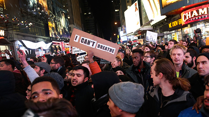 Demonstrators fill 7th Avenue in Times Square as they protest a grand jury decision not to charge a New York policeman in the choking death of Eric Garner, in New York December 4, 2014 (Reuters / Mike Segar)