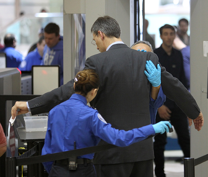 An air traveler is patted down after passing through a full-body scanner at Los Angeles International Airport (LAX) (AFP Photo / David McNew)
