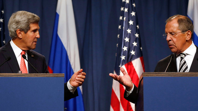 U.S. Secretary of State John Kerry (L) and Russian Foreign Minister Sergei Lavrov gesture, following meetings regarding Syria, at a news conference in Geneva September 14, 2013.( Reuters / Larry Downing)
