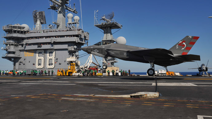 F-35C Lightening II carrier variant Joint Strike Fighter conducting it's first arrested landing aboard the aircraft carrier USS Nimitz.(AFP Photo / Kelly M. Agee)