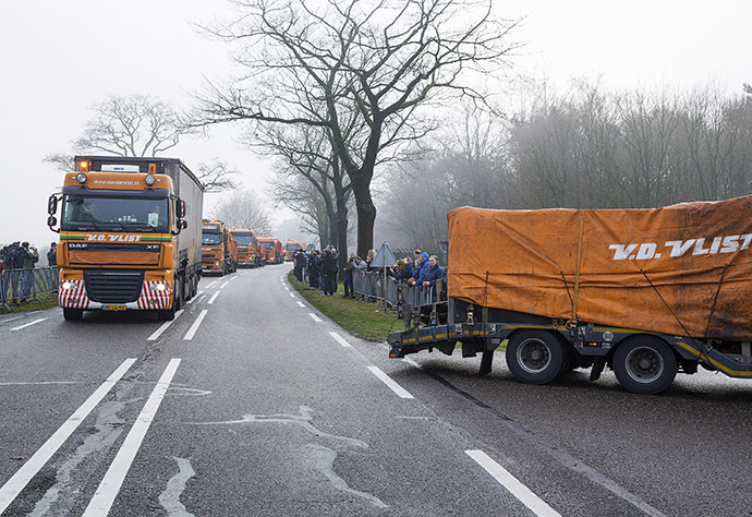Trucks carrying wreckage from Malaysia Airlines flight MH17 arrive at a Dutch airforce base in the southern town of Gilze-Rijen December 9, 2014. (Reuters/Michael Kooren)
