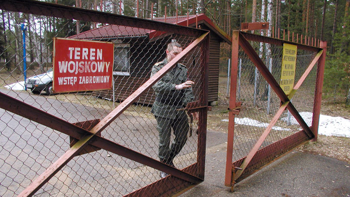 A guard shuts the gate to the airport in Szymany in northeastern Poland in this file 2005 picture. Polish media said November 5, 2005 the airport was identified by Human Rights Watch as a potential site of alleged CIA prisons used to interrogate al Qaeda captives. Poland strongly denied it was hosting such facilities.(Reuters / Tomasz Marek)