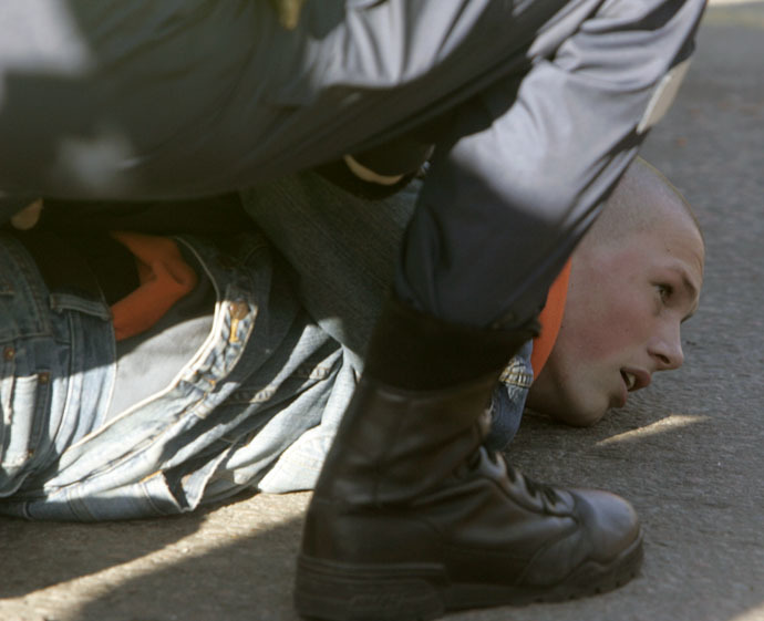 Estonian riot police arrest a Russian-speaking protestor demonstrating against the removal of a bronze statue of a Red Army Soviet soldier in Tallinn April 27, 2007. (Reuters/Ints Kalnins)
