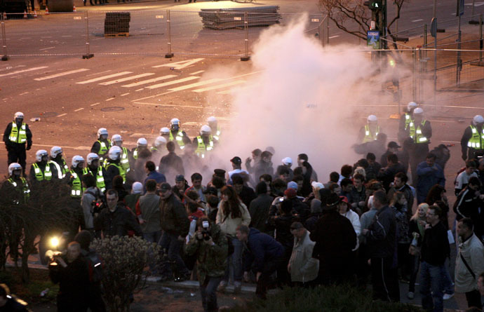 Riot policemen use tear gas during clashes with protesters demonstrating against the government's decision to close the entrance to the Bronze Soldier monument in downtown Tallinn April 26, 2007. (Reuters)
