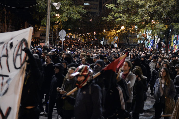 Thousands march in central Athens on December 2, 2014 during a massive march in solidarity with a 22-years old anarchist hunger striker, Nikos Romanos.(AFP Photo)
