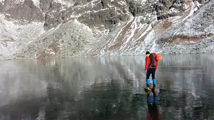 Icy walk on crystal clear mountain lake in Slovakia awes web (VIDEO)