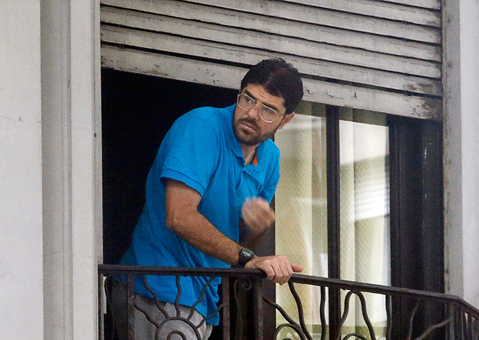 Syrian Omar Mahmoud Faraj stands on the balcony of a house he shares with five other former Guatanamo detainees, in a neighbourhood in Montevideo December 12, 2014 (Reuters / Andres Stapff)