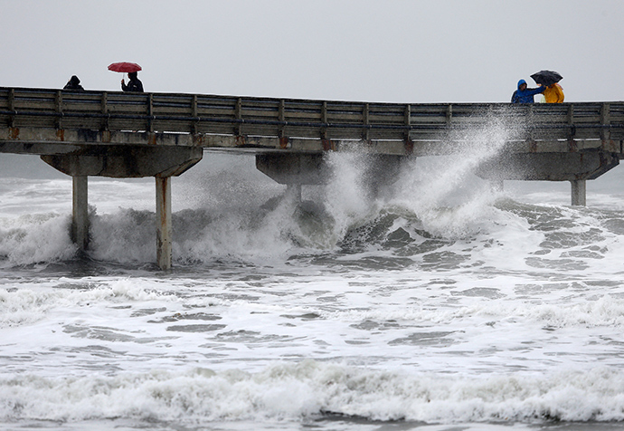 High waves crash under the Ocean Beach Pier as a winter storm brings rain and high winds to San Diego, California December 12, 2014 (Reuters / Mike Blake)