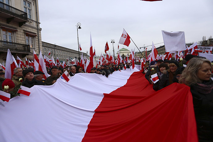 Protesters carry Polish flags during a demonstration march in Warsaw December 13, 2014. (Reuters/Adam Stepien/Agencja Gazeta)