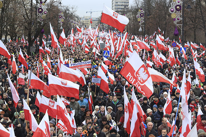 People carry Polish flags during a demonstration march in Warsaw December 13, 2014. (Reuters/Jacek Marczewski/Agencja Gazeta)
